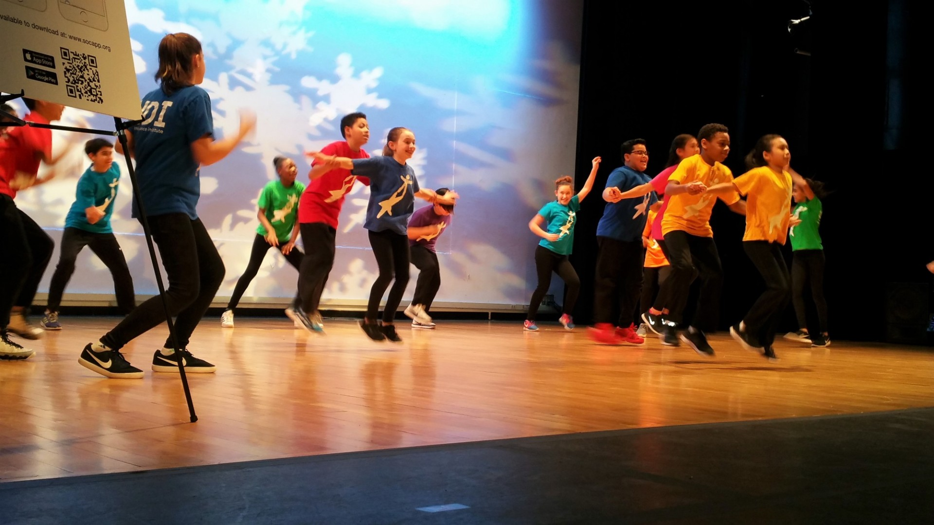 Students dance on stage at Miller Theater