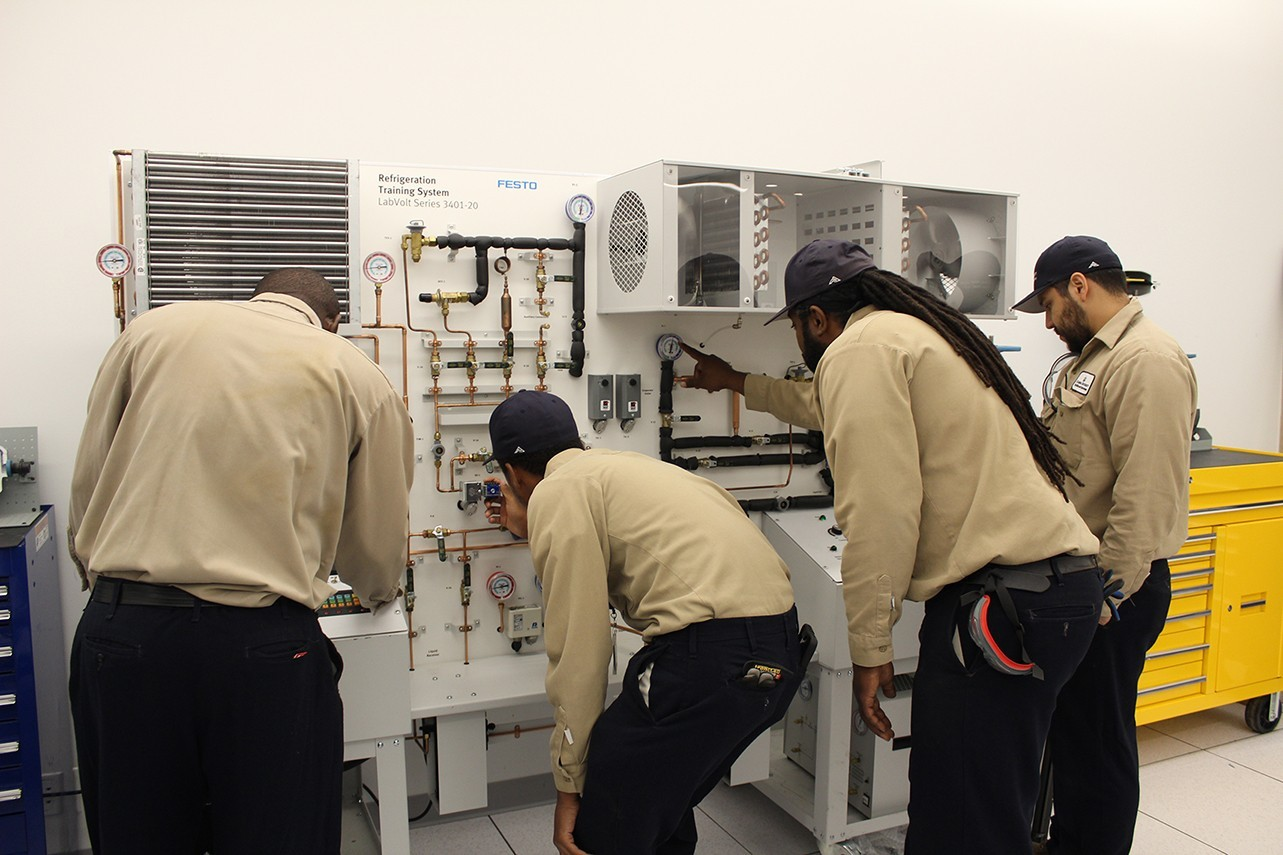Apprentices (l to r) Evans Ampofo, Gary Hamilton, Keith DeFreitas, and Alphonso Espinoza receiving hands-on classroom training in the Studebaker Building at Columbia's Manhattanville Campus.