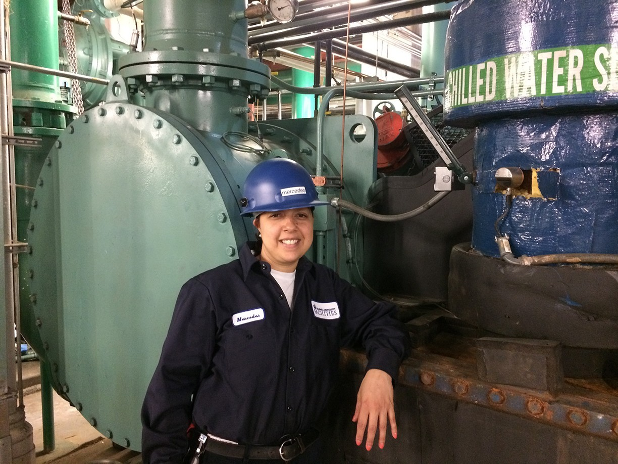 Mercedes Santana, mechanic trainee, at the chiller plant on Columbia's Morningside campus.