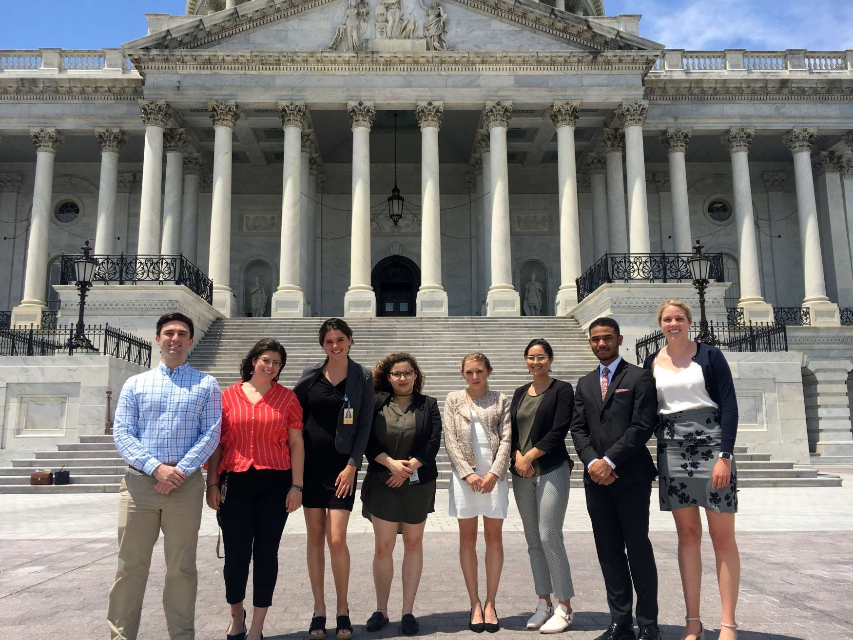 Summer 2019 congressional interns from Columbia standing in front of the Capitol building. (Left to right: Noah Chase Widmann CC'20; Sofia Garcia-George CC'21; Lilly Anderson, Barnard '21; Nada Zohayr CC'21; Emily Digman CC'20; Ciara Johnson CC'21; Kareem Sidibe CC'22; Allyssa Phelps CC'21)